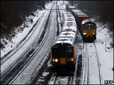 Trains on snowy tracks in Hampshire