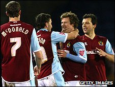 Burnley players celebrate their opener against West Brom