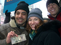 Couple with a $50 note