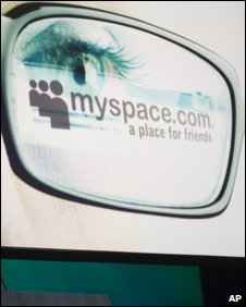 MySpace logo reflected in glasses (AP)