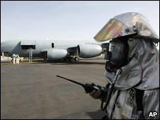 US serviceman stands in front of S-135 aircraft during American-French joint exercises at the US Manas Air Base in 2007