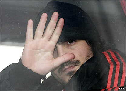 Rino Gattuso waves from the team bus