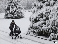 A woman pushing a pram in Aviemore, Scotland