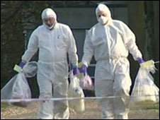 Scene of crime officers bringing out petrol bombs found at Templeton College, Oxford