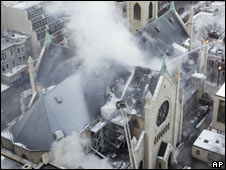 Plumes of smoke billow from Chicago's Holy Name Cathedral