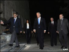Joe Biden (centre) arrives for a meeting at the presidential palace in Kabul
