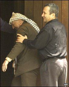Arafat pushed by Barak into negotiated room at Camp David