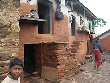 House in Dil with confinement shed in bottom left of picture