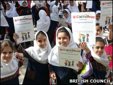 Iranian girls hold up certificates from a British Council reading programme (British Council handout)