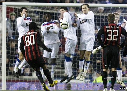 Ronaldinho curls a free-kick at the Rangers wall