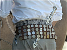 An Argentine man with a belt of coins. Archive photo