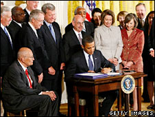 US President Barack Obama signs the SCHIP bill in the White House