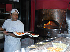 Egyptian pizza chef in Milan