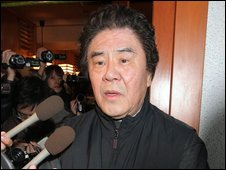 Kazutsugi Nami speaks to the press before being arrested by police in Tokyo on February 5, 2009.