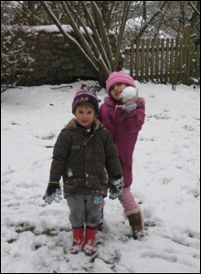 Hana and William enjoying playing in the snow (Picture:Sue Martin)