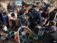 Villagers queue for drinking water in China's Henan province (4 February)