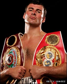 Calzaghe poses with the WBO and WBC super-middleweight betlls