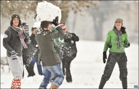 People throw snowballs in Victoria Park, Windmill Hill, Bristol
