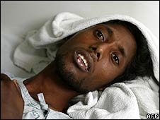 An injured Rohingya man rests in hospital in Thailand (31 January)