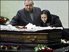 Eduardr and Larisa Baburov pay their last respects to their daughter Anastasia Baburova