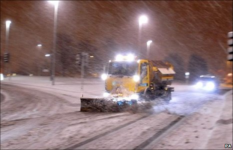 A snowplough battles through at Middlemoor, Exeter.