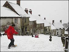 Snowboarder on Gold Hill, Shaftesbury