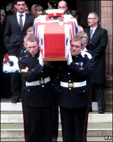 The coffin of Corporal Danny Winter is carried from his funeral service at St George's Church