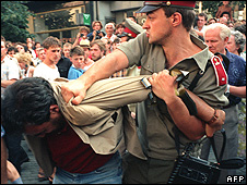 Communist police arrest a Czech demonstrator, 21 Aug 89