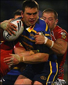 Kevin Sinfield takes on the Crusaders defence