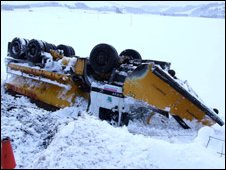 An overturned snow plough