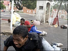 "A man tries to run from gun shots near Madagascar President Marc Ravalomanana""s offices in Antananarivo on February 7, 2009"