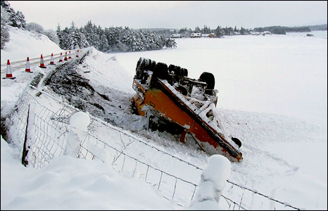 A snow plough slips off the road. Photo: Neil Robertson