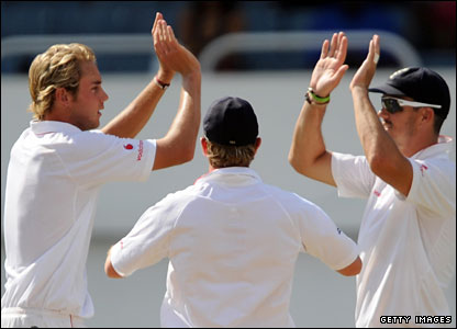 Stuart Broad (left) celebrates the dismissal of Sulieman Benn with Ian Bell and Kevin Pietersen