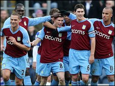 James Milner and his Aston Villa team-mates celebrate after his goal at Blackburn