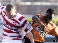 Brian Easton (left) holds off Dundee United's Morgaro Gomis