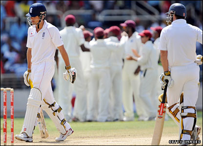 Alastair Cook (left) walks off after edging to second slip, watched by partner Andrew Strauss (right)