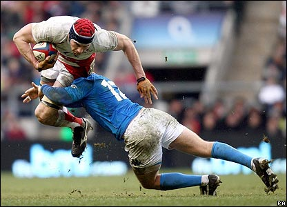 England's Nick Kennedy is tackled by Gonzalo Gaecia