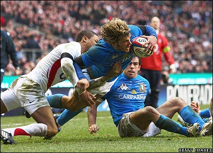 Italy's Mirco Bergamasco dives over for a deserved try