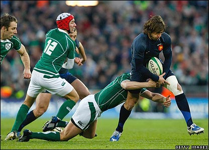 French winger Maxime Medard is tackled by Ronan O'Gara