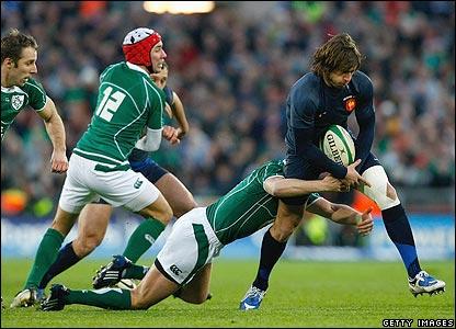 French winger Maxime Medard is tackled by Ronan O'Gara