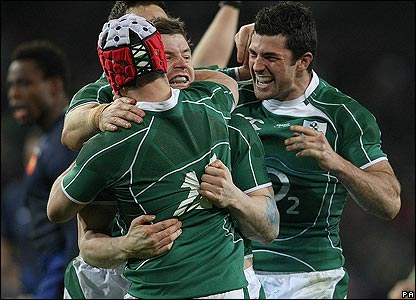 Brian O'Driscoll is mobbed by his Ireland team-mates after scoring his try
