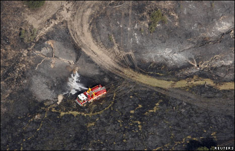 Firetruck among wreckage and burned ground at Wandong