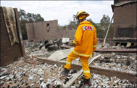 Firefighter in wreckage of home at Wandong