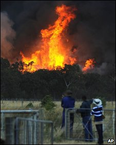 People watch flames in Bunyip State Forest, Victoria