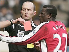 Arsenal's Emmanuel Eboue is shown the red card against Tottenham at White Hart Lane
