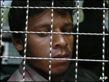 A Rohingya migrant in a police van in Thailand, 31/01