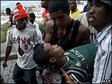 Wounded man being carried after Saturday's unrest