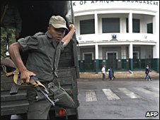 A soldier descends from a truck near the office of the president in Antananarivo on 9 February 2009