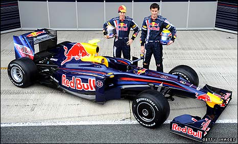 Sebastian Vettel and Mark Webber pose with the new Red Bull F1 car