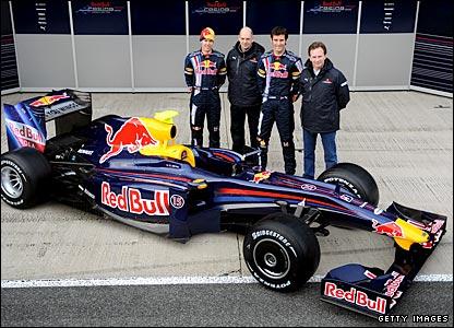 (Left to right) Sebastian Vettel, chief technical officer Adrian Newey, Mark Webber and team principal Christian Horner with the new Red Bull